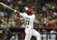 PHOENIX, AZ - APRIL 26:  Alfredo Marte #17 of the Arizona Diamondbacks hits an RBI single against the Colorado Rockies in the second inning at Chase Field on April 26, 2013 in Phoenix, Arizona.  The Rockies defeated the Diamondbacks 6 to 3.  (Photo by Jennifer Stewart/Getty Images)