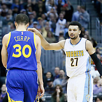 13 February 2017: Denver Nuggets guard Jamal Murray (27) celebrates in front of Golden State Warriors guard Stephen Curry (30) during the Denver Nuggets 132-110 victory over the Golden State Warriors, at the Pepsi Center, Denver, Colorado, USA.