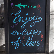 Coffee Blackboard humorous  outdoor sign. <br /> &quot;Enjoy a cup of Love&quot;. <br /> <br /> BIRCH coffee on 7th Ave, NYC