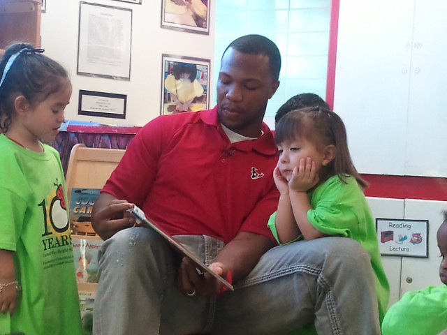 Houston Texans safety Glover Quin reads to children at Waltrip High School's Child Development Center in conjunction with the United Way of Greater Houston.<br /> To submit photos for inclusion in eNews, send them to hisdphotos@yahoo.com.