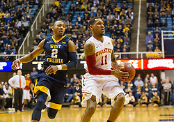 Feb 22, 2016; Morgantown, WV, USA; Iowa State Cyclones guard Monte Morris (11) dribbles past West Virginia Mountaineers guard Jevon Carter (2) during the first half at the WVU Coliseum. Mandatory Credit: Ben Queen-USA TODAY Sports
