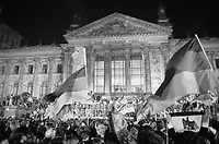 """ca. October 2-3, 1990, Berlin, Germany --- Crowds converge on the Reichstag, the past and future seat of the German Parliament, at midnight on October 2-3, 1990, the moment that the official reunification of East and West Germany took effect.  The inscription on the building aptly reads """"To the German People"""" --- Image by © Owen Franken/CORBIS"""