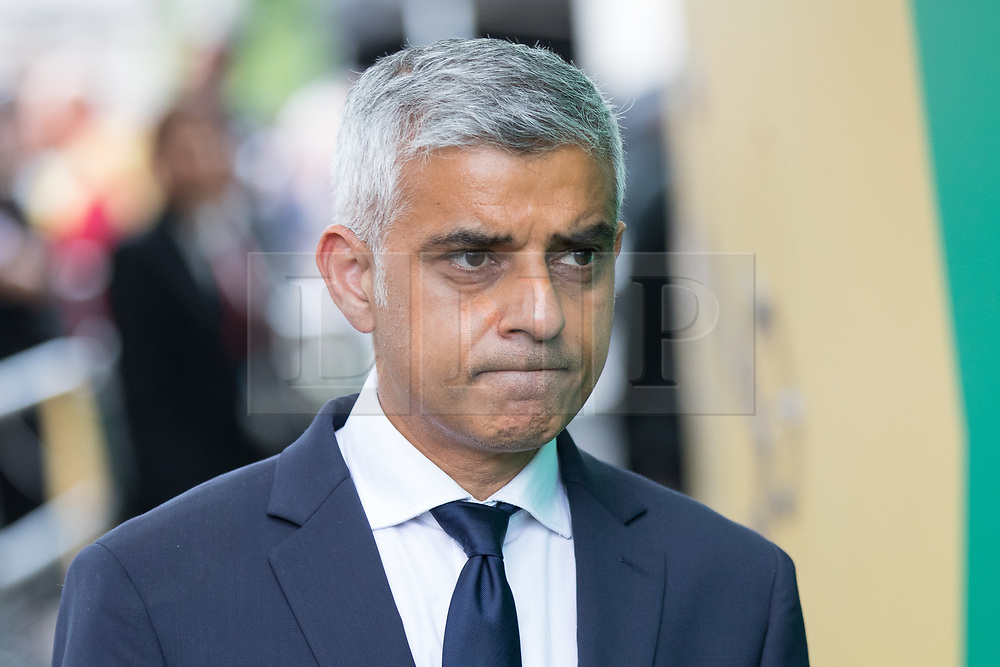 © Licensed to London News Pictures. 03/06/2018. London, UK. Mayor of London Sadiq Khan leaves after laying flowers to mark one year since the London Bridge and Borough Market terror attacks. A series of events have taken place throughout the day, including a service of commemoration at Southwark Cathedral, the planting of an olive tree in the Cathedral grounds, a minute's silence at 4:30pm and the laying of flowers.  Photo credit : Tom Nicholson/LNP