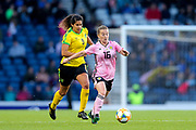 Christie Murray (#16) of Scotland on the ball under pressure from Marlo Sweatman (#9) of Jamaica during the International Friendly match between Scotland Women and Jamaica Women at Hampden Park, Glasgow, United Kingdom on 28 May 2019.