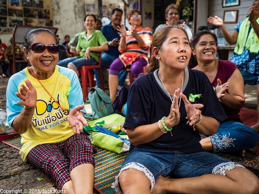 07 SEPTEMBER 2016 - BANGKOK, THAILAND: A community meeting in the Pom Mahakan community. Forty-four families still live in the Pom Mahakan Fort community. The city of Bangkok has given them provisional permission to stay, but city officials say the permission could be rescinded and the city go ahead with the evictions. The residents of the historic fort have barricaded most of the gates into the fort and are joined every day by community activists from around Bangkok who support their efforts to stay.      PHOTO BY JACK KURTZ