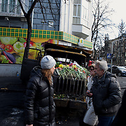 KIEV, UKRAINE - February 24, 2014: People pass by a burned police truck in a access street to the Ukraine parliament building in Kiev. CREDIT: Paulo Nunes dos Santos