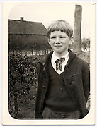 young boy posing for a photograph early 1970s