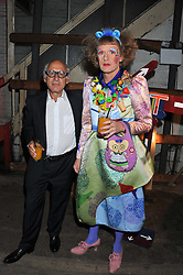 Left to right, MICHAEL NYMAN and GRAYSON PERRY at the Contemporary Art Society's Gala evening held at the Farmiloe Buildings, St.John Street, London EC1 on 29th February 2012.