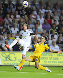 "Swansea City's Pablo Hernandez battles for the ball with Petrolul Ploiesti's Alexandru Benga  - Photo mandatory by-line: Joe Meredith/JMP - Tel: Mobile: 07966 386802 22/08/2013 - SPORT - FOOTBALL - Liberty Stadium - Swansea -  Swansea City V Petrolul Ploiesti - Europa League Play-Off EDITORIAL USE ONLY. No use with unauthorised audio, video, data, fixture lists, club/league logos or ""live"" services. Online in-match use limited to 45 images, no video emulation. No use in betting, games or single club/league/player publications"