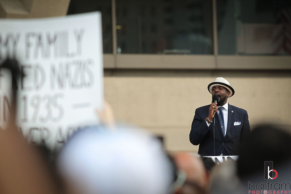 Rev. Michael Waters, senior pastor of Joy Tabernacle AME Church and one of the leaders of Faith Forward Dallas, speaks during an anti white-supremacy rally at Dallas City Hall plaza on Saturday, Aug. 19, 2017. (Photo by Kevin Bartram)