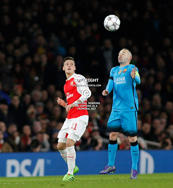 LONDON, ENGLAND - FEBRUARY 23: Mesut Ozil of Arsenaland Andres Iniesta of Barcelona during the Champions League match between Arsenal and Barcelona at The Emirates Stadium on February 23, 2016 in London, United Kingdom. (Photo by Mitchell Gunn/ESPA-Images)