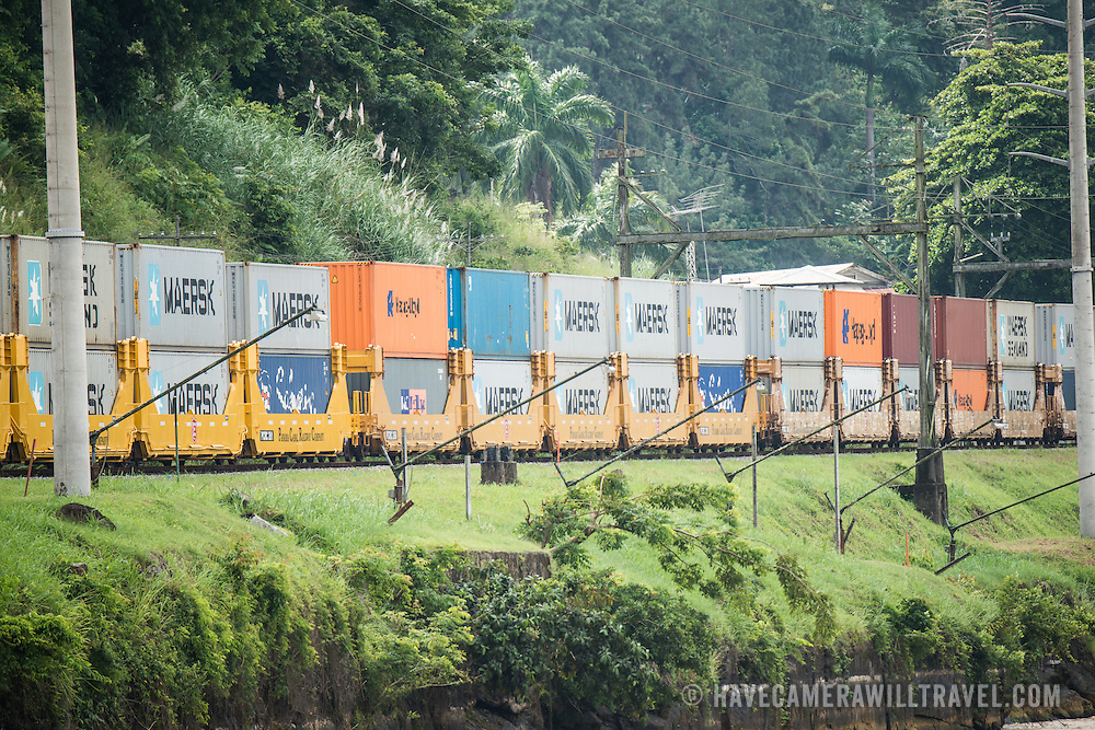A train carrying shipping containers on the Panama Canal Railway. Opened in 1914, the Panama Canal is a crucial shipping lane between the Atlantic and Pacific Oceans that mean that ships don't have to go around the bottom of South America or over the top of Canada. The Canal was originally built and owned by the United States but was handed back to Panama in 1999.