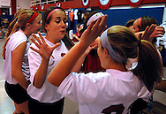 10 DEC. 2010 -- ST. LOUIS -- Assumption School volleyball players Jenna Wolf (25, left) and Cori Benach (22) celebrate after beating Holy Infant School during the championship match of the CYC girls' parochial closed division tournament at the Monsignor Meyer Youth Center in St. Louis Friday Dec. 10, 2010. Image © copyright 2010 Sid Hastings.