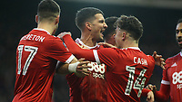 Eric Lichaj is congratulated on putting Forest ahead against Arsenal  during The Emirates FA Cup Third Round match between Nottingham Forest and Arsenal at City Ground on January 7, 2018 in Nottingham, England.