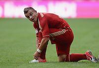 FUSSBALL   1. BUNDESLIGA  SAISON 2012/2013   3. Spieltag FC Bayern Muenchen - FSV Mainz 05     15.09.2012 Xherdan Shaqiri (FC Bayern Muenchen) bindet sich die Schuhe