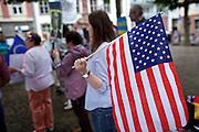 Frankfurt am Main | 05 July 2014<br /> <br /> Am Samstag (05.07.2014) demonstrierten am Domplatz in Frankfurt am Main etwa 25 Menschen f&uuml;r die Unabh&auml;ngigkeit der Ukraine und gegen den Einfluss von Russland.<br /> Hier: Eine Teilnehmerin der Demo mit einer Flagge der USA.<br /> <br /> [Foto honorarpflichtig, kein Model Release]<br /> <br /> &copy;peter-juelich.com