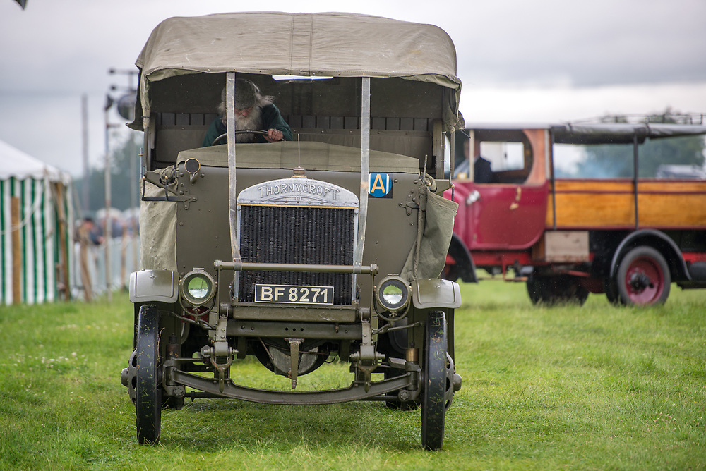 Front view of vintage Thornycroft truck being driven by mature male with a beard, Masham, North Yorkshire, UK