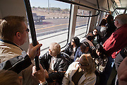 28 DECEMBER 2008 -- PHOENIX, AZ: Passengers ride a new Metro train in Phoenix, AZ, Sunday. Most of the trains over the weekend were full with passengers standing and learning to grip the handrails. The new Metro Light Rail is 20 miles long and cost $1.4 billion dollars. Construction was funded by local, state and federal monies. The trains will operate on one line through Phoenix and the suburban communities of Tempe and Mesa. The trains started running Saturday, Dec 27, 2008 and will be free until Jan. 1, 2009. The regular fare will be $1.25 for one ride or $2.50 for an all day pass.  Photo by Jack Kurtz / ZUMA Press