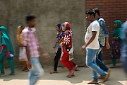 Garment workers walking to work at Epyllion Group garment factory in Bangladesh.