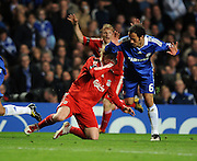 Fernando Torres of Liverpool is fouled by Ricardo Carvalho of Chelsea during the UEFA Champions League Quarter Final Second Leg match between Chelsea and Liverpool at Stamford Bridge on April 14, 2009 in London, England.