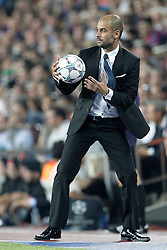 Barcelona's Josep Guardiola catches the ball during Champions League match on september 13th 2011.