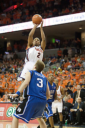Virginia's J.R. Reynolds (2) shoots over Duke's Greg Paulus (3) as The University of Virginia Cavaliers beat the #8 ranked Duke University Blue Devils 68-66 in overtime at the John Paul Jones Arena in Charlottesville, VA on February 1, 2007...