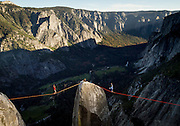 Two slackliners walk with almost 3000' of exposure to Lost Arrow Sprire, arguably the birthplace of modern highlining.<br />