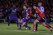 GOAL John Akinde (29) part obscured shoots during the EFL Sky Bet League 1 match between Lincoln City and Tranmere Rovers at Sincil Bank, Lincoln, United Kingdom on 14 December 2019.