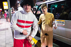 © Licensed to London News Pictures . 26/12/2017. Wigan, UK. Revellers in Wigan enjoy Boxing Day drinks and clubbing in Wigan Wallgate . In recent years a tradition has been established in which people go out wearing fancy-dress costumes on Boxing Day night . Photo credit: Joel Goodman/LNP