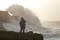 © Licensed to London News Pictures. 04/10/2019. Porthcawl, Bridgend, Wales, UK. Large waves hit the harbour wall as Storm Lorenzo, named after ex-hurricane Lorenzo, by Met Éireann, hits the Welsh seaside resort of Porthcawl in Bridgend, UK. Photo credit: Graham M. Lawrence/LNP