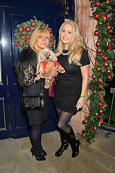Left to right, VICTORIA EISERMANN and CONSTANCE GOTSOPOULOU with Loui the dogat a recption hosted by the Dogs Trust held at George, 87-88 Mount Street, London on 23rd November 2015.