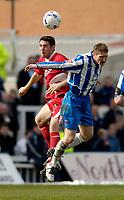 Photo: Jed Wee.<br />Hartlepool United v Bristol City. Coca Cola League 1. 15/04/2006.<br /><br />Bristol City's Bradley Orr (L) outjumps Hartlepool's Eifion Williams.