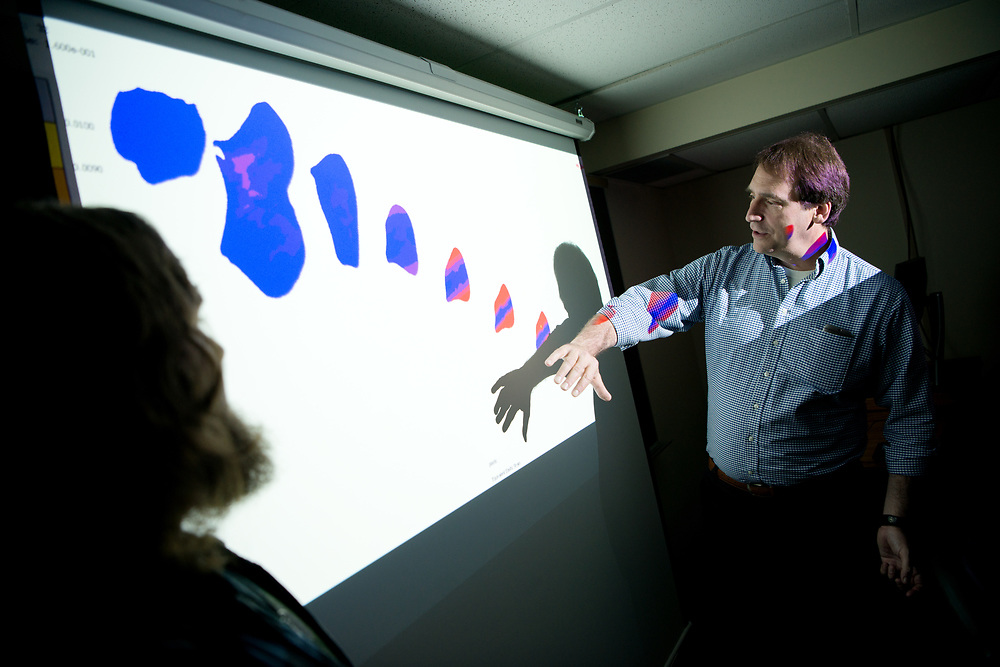 John Cotton (Right), Associate Professor, Mechanical Engineering and Biomedical Engineering at the Russ College of Engineering and Technology discusses a compuer simulation of stress on an ulna with graduate student Travis Moleski. Photo by Ben Siegel