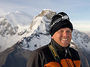 James Voortman on the summit of Pisco, at dawn on 22 June 2008.  Behind, from left to right, are the summits of Huascarán Sur (South) 6,768m and Huascarán Norte (North) 6,664m.