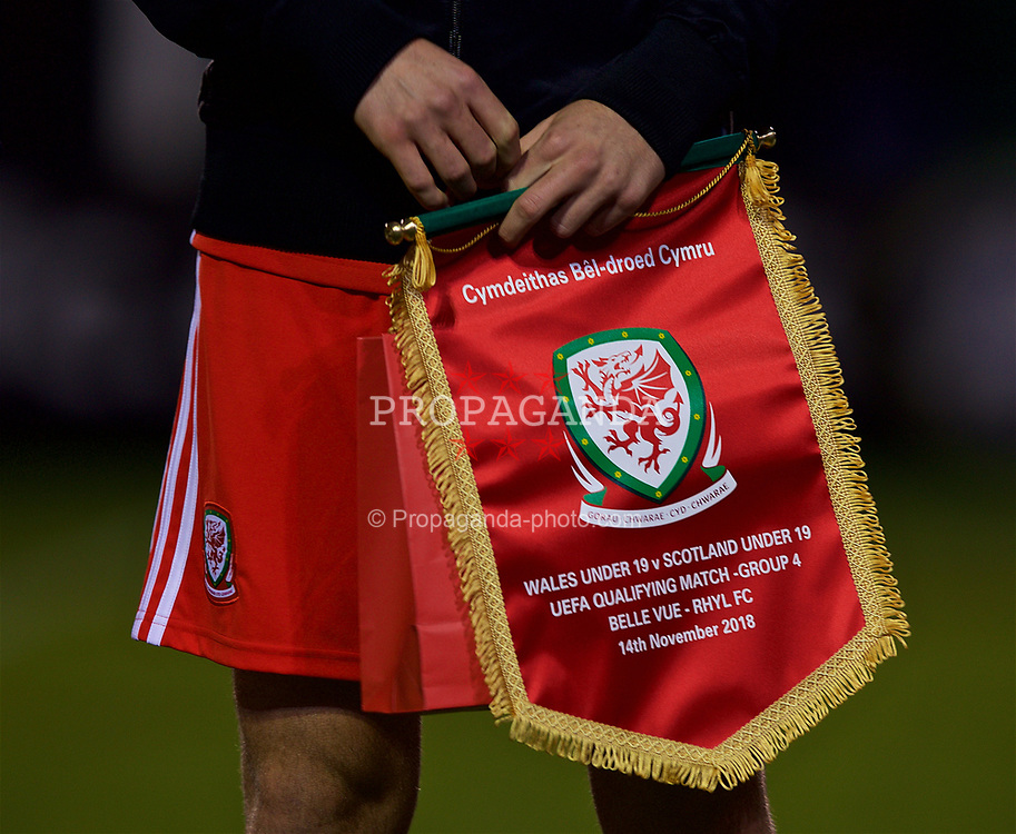 RHYL, WALES - Wednesday, November 14, 2018: Wales' captain Ryan Reynolds holds the FAW match pennant before the UEFA Under-19 Championship 2019 Qualifying Group 4 match between Wales and Scotland at Belle Vue. (Pic by Paul Greenwood/Propaganda)