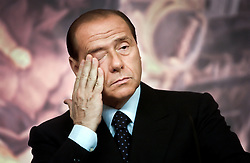 Silvio Berlusconi, Italy's prime minister, reacts during a press conference after the official ceremony of the European Convention where Berlusconi received the first draft of the European Constitution, in Rome, Italy, on Wednesday, June 18, 2003. (Photo © Jock Fistick)
