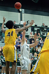 21 February 2017:  Trevor Seibring works his way to the lane and bucket against defender Micah Martin during an College men's division 3 CCIW basketball game between the Augustana Vikings and the Illinois Wesleyan Titans in Shirk Center, Bloomington IL