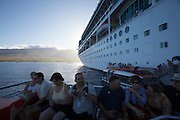 Western Maui, the Rhapsody of the Seas anchoring off Lahaina. Passengers going ashore with tender boats.