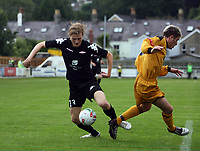 Photo: Rich Eaton.<br /> <br /> Carmarthen Town v SK Brann. UEFA Cup Qualifying. 19/07/2007. SK Brann's Erik Huseklepp (l) attacks past Carmarthen's Kris Thomas.
