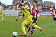 Ilias Chatzitheodoridis and Lloyd James during the EFL Sky Bet League 2 match between Exeter City and Cheltenham Town at St James' Park, Exeter, England on 2 April 2018. Picture by Antony Thompson.