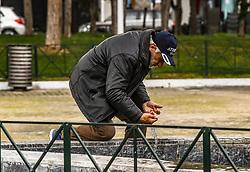 A homeless man washing his hands on a fountain in Athens, Greece on March 23, 2020 as the country is battling hard to control the spread of the COVID-19, the novel coronavirus. Greek Prime Minister announced a ban on public movement starting at 06:00 am on March 23, 2020 to stem the spread of the global coronavirus pandemic in Greece.<br /> <br /> Pictured: <br /> Dimitris Lampropoulos  | EEm date