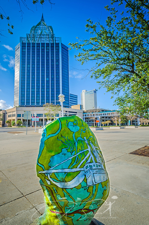 A painted fiberglass oyster stands on Water Street in downtown Mobile, November 27, 2015, in Mobile, Alabama. The oysters, painted by local artists, are scattered throughout the city as part of a campaign to raise awareness of the oyster's importance to the region. This oyster shell was painted by local artist Ameri'ca Jones and sponsored by Felix's Fish Camp and Bluegill Restaurant. (Photo by Carmen K. Sisson/Cloudybright)