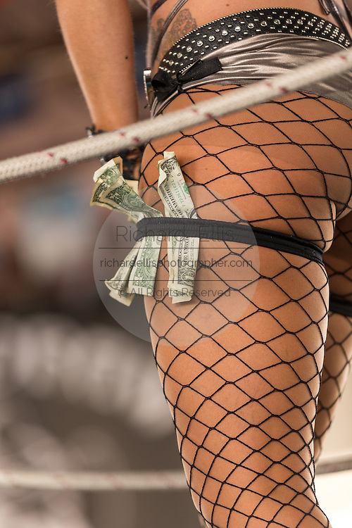 Dollar bills hand from the stocking of an exotic dancer on Main Street during the 74th Annual Daytona Bike Week March 7, 2015 in Daytona Beach, Florida.