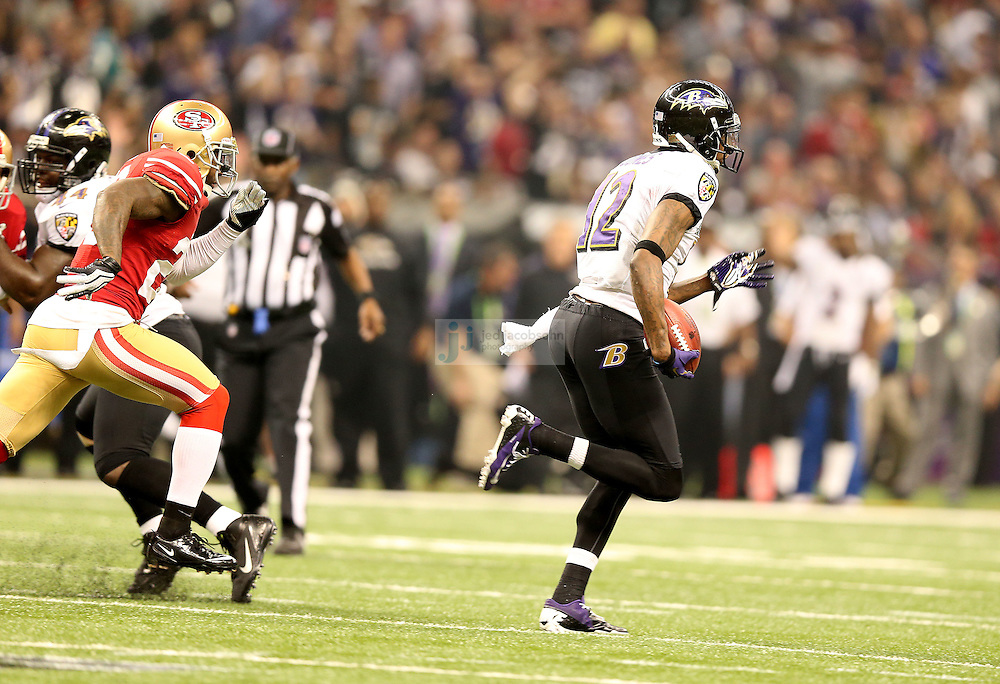 Jacoby Jones (12) of the Baltimore Ravens returns a kick off for a touchdown against the the San Francisco 49ers during the NFL Super Bowl XLVII football game in New Orleans on Feb. 3, 2013. The Ravens won the game, 34-31.  (Photo by Jed Jacobsohn)