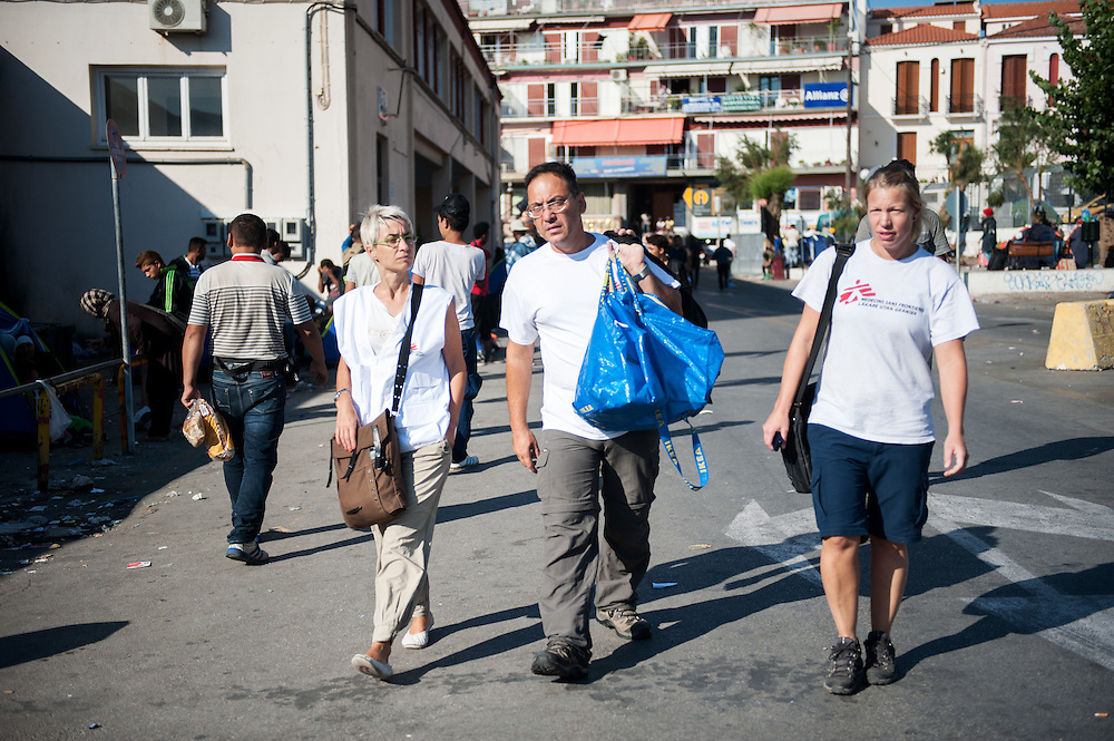 MSF doctor Dimitris Giannousis and MSF nurse Ida Tornstensson together with MSF Campaign manager (?) Mitsi Persani walk towards the MSF mobile unit at the pot of Mytiline.
