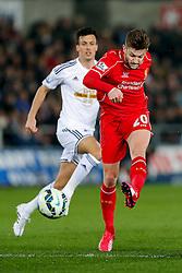 Adam Lallana of Liverpool shoots - Photo mandatory by-line: Rogan Thomson/JMP - 07966 386802 - 16/03/2015 - SPORT - FOOTBALL - Swansea, Wales — Liberty Stadium - Swansea City v Liverpool - Barclays Premier League.