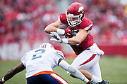FAYETTEVILLE, AR - OCTOBER 31:  Hunter Henry #84 of the Arkansas Razorbacks is hit by Terrious Triplett #2 of the UT Martin Skyhawks at Razorback Stadium on October 31, 2015 in Fayetteville, Arkansas.  The Razorbacks defeated the Skyhawks 63-28.  (Photo by Wesley Hitt/Getty Images) *** Local Caption *** Hunter Henry; Terrious Triplett