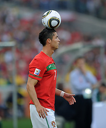 CRISTIANO RONALDO (Portugal) balances the ball on his head during the 2010 FIFA World Cup South Africa Group G match between Portugal and Brazil at Durban Stadium on June 25, 2010 in Durban, South Africa.