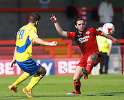 Crawley Town midfielder Luke Rooney flicks the ball forward under pressure from Accrington Stanley midfielder Seamus Conneely during the Sky Bet League 2 match between Crawley Town and Accrington Stanley at the Checkatrade.com Stadium, Crawley, England on 26 September 2015. Photo by Bennett Dean.