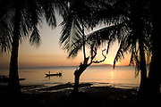 A fisherman arrives home to Kep, Cambodia after a day of fishing on the Gulf of Thailand.